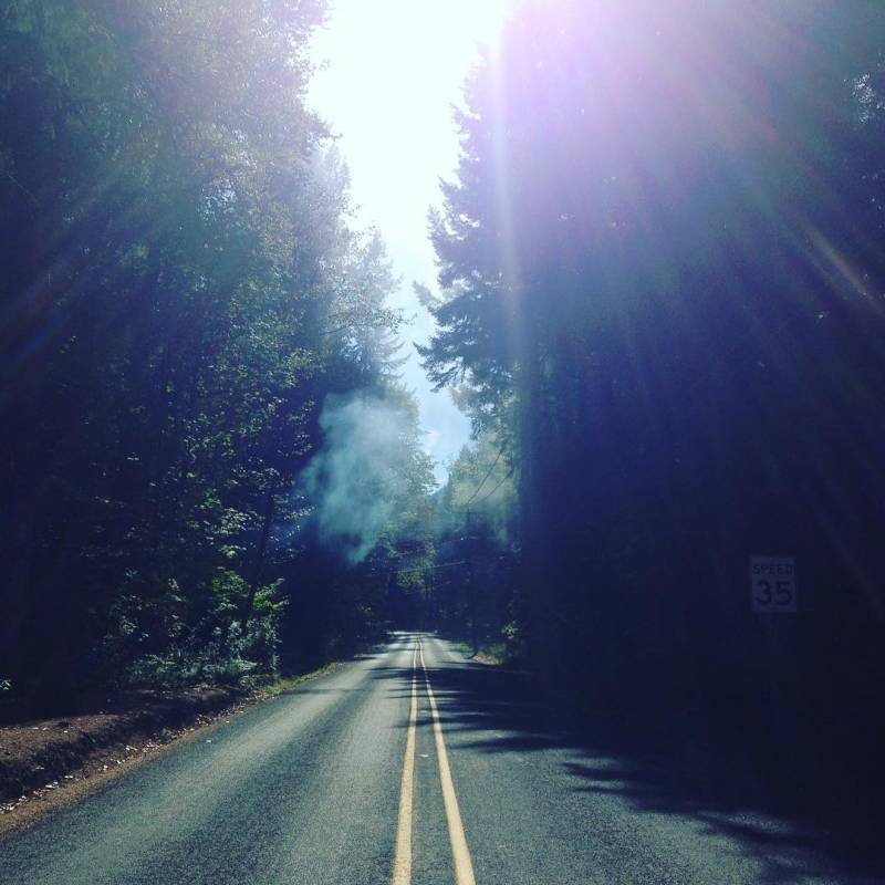 Smoke and mountain road.